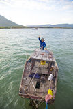 Vietnamese fisherman withdrawing net Stock Images