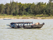 Vietnamese fishermen on a boat catching fish, Mekong river delta area royalty free stock images