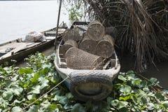 Vietnamese fishermen Boat, Mekong River, Vietnam. Fishermen Boat with basket to fish in the Mekong River, Vietnam Royalty Free Stock Photo