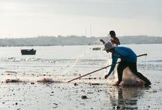 Vietnamese fishermen fold nets Royalty Free Stock Image
