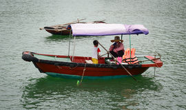 Vietnamese fishermen are relaxing on their boats in Haiphong Stock Photos