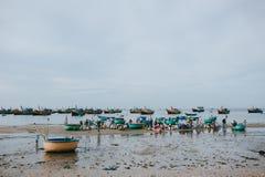 vietnamese fishermen with seafood on sandy beach at Mui Ne, Vietnam royalty free stock photos