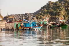 Vietnamese fishermen style of life. Ha Long Bay, Vietnam-December 18, 2013.  Vietnamese fishermen are relaxing on their fishing boats and houseboat in Ha Long Royalty Free Stock Photos
