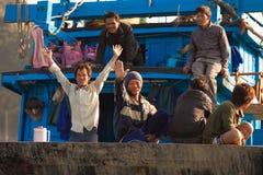 Vietnamese fishermen welcomes tourist Royalty Free Stock Photo