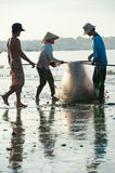 Vietnamese fishers pack nets Royalty Free Stock Photo
