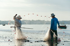 Vietnamese fishers pack their nets Stock Image