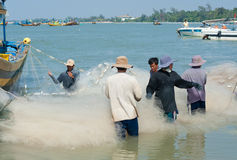 Vietnamese fishers untangle nets Stock Photo