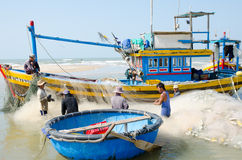 Vietnamese fishers at work Stock Photos