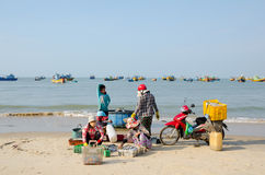 Vietnamese fishers work Stock Photo