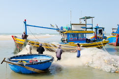 Vietnamese fishers at work Stock Image