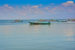 Vietnamese Fishing Boats in Calm Azure Sea up to Horizon Stock Photography