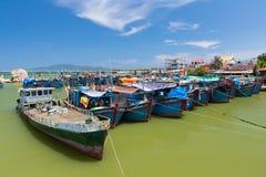 Vietnamese fishing boats in the port. Nah Trang, Vietnam - April 14, 2014: Vietnamese fishing boats in the port near Nha Trang city on April 14, 2014, Vietnam stock photography