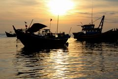 Vietnamese fishing boats. On the sea at sunset Royalty Free Stock Image