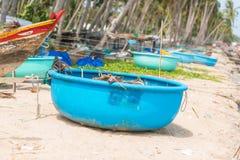 Vietnamese fishing coracles on beach, tribal boats at fishing vi Royalty Free Stock Photos