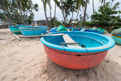 Vietnamese fishing coracles on beach, tribal boats at fishing vi Stock Photo
