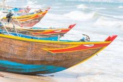 Vietnamese fishing coracles on beach, tribal boats at fishing vi Stock Photos