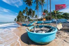 Vietnamese fishing coracles on beach, tribal boats at fishing village Royalty Free Stock Photography