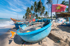 Vietnamese fishing coracles on beach, tribal boats at fishing village Royalty Free Stock Images