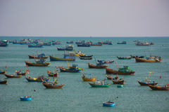 Vietnamese fishing village with  traditional colorful fishing bo Royalty Free Stock Images