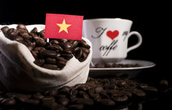 Vietnamese flag in a bag with coffee beans  on black Royalty Free Stock Photography