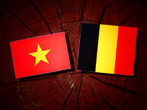 Vietnamese flag with Belgian flag on a tree stump isolated Royalty Free Stock Photography