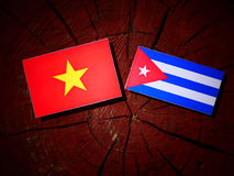 Vietnamese flag with Cuban flag on a tree stump isolated Stock Photo