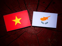 Vietnamese flag with Cypriot flag on a tree stump isolated Royalty Free Stock Photography