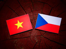 Vietnamese flag with Czech flag on a tree stump  Royalty Free Stock Photography