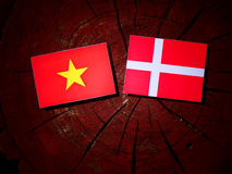 Vietnamese flag with Danish flag on a tree stump isolated Royalty Free Stock Photos