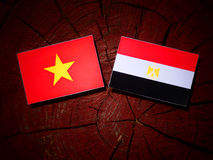 Vietnamese flag with Egyptian flag on a tree stump  Royalty Free Stock Images