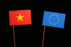 Vietnamese flag with European Union EU flag  on black Royalty Free Stock Image