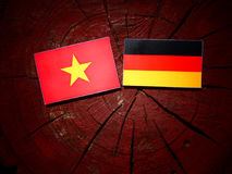 Vietnamese flag with German flag on a tree stump  Royalty Free Stock Photography