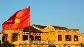 Vietnamese flag. Hoi An ancient town. Vietnam Stock Photos