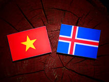 Vietnamese flag with Icelandic flag on a tree stump isolated Stock Photography