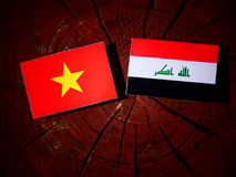 Vietnamese flag with Iraqi flag on a tree stump isolated Royalty Free Stock Image