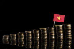 Vietnamese flag with lot of coins  on black Stock Photos
