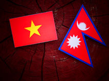Vietnamese flag with Nepali flag on a tree stump isolated Royalty Free Stock Images