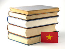 Vietnamese flag with pile of books  on white background Stock Images