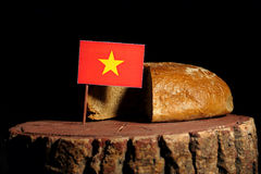 Vietnamese flag on a stump with bread Stock Photo