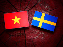 Vietnamese flag with Swedish flag on a tree stump  Stock Photography