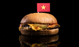 Vietnamese flag on top of hamburger  on black Royalty Free Stock Photography
