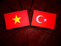 Vietnamese flag with Turkish flag on a tree stump  Stock Image
