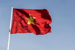 Vietnamese flag waving in the wind on a pole. Against a blue sky background Stock Photography