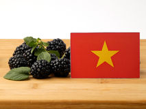 Vietnamese flag on a wooden panel with blackberries isolated on Stock Photography