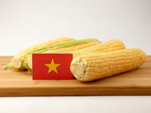 Vietnamese flag on a wooden panel with corn isolated on a white Royalty Free Stock Photography