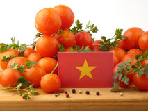 Vietnamese flag on a wooden panel with tomatoes isolated on a wh Royalty Free Stock Photo