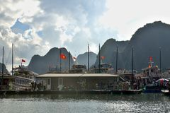 Vietnamese Floating Fishing Village. A photo of a part of a floating fishing village in Halong Bay, Vietnam Stock Image