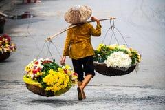 Vietnamese florist vendor in Hanoi stock image