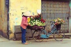 Vietnamese florist vendor in Hanoi. Vietnam farmer selling flower in small market in hanoi, vietnam royalty free stock image