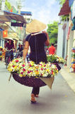Vietnamese florist vendor in Hanoi. Vietnam farmer selling flower in small market in hanoi, vietnam Stock Photography